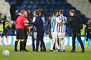 Players and officials shake hands at full time during the EFL Sky Bet Championship match between Huddersfield Town and Brentford at the John Smiths Stadium, Huddersfield, England on 18 January 2020.