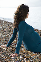 Pregnant woman relaxing on beach