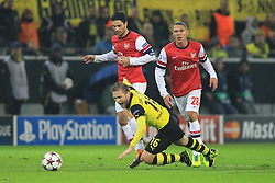 "06.11.2013, Signal Iduna Park, Dortmund, GER, UEFA CL, Borussia Dortmund vs FC Arsenal, Gruppe F, im Bild Mikel Arteta #8 (Arsenal FC) foult Jakub ""Kuba"" Blaszczykowski #16 (Borussia Dortmund) mit Kieran Gibbs #28 (Arsenal FC), Aktion, Action // UEFA Champions League group A match between Borussia Dortmund and Arsenal FC at the Signal Iduna Park in Dortmund, Germany on 2013/11/06. EXPA Pictures © 2013, PhotoCredit: EXPA/ Eibner-Pressefoto/ Schueler<br /> <br /> *****ATTENTION - OUT of GER*****"