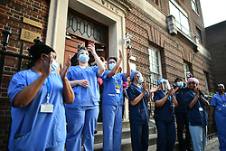 © Licensed to London News Pictures. 07/05/2020. London, UK. Medical staff at St Mary's Hospital in West London take part in 'Clap For Our Carers' by applauding NHS workers, carers and key workers. Government is set to announce measures to easy lockdown, which was introduced to fight the spread of the COVID-19 strain of coronavirus. . Photo credit: Ben Cawthra/LNP