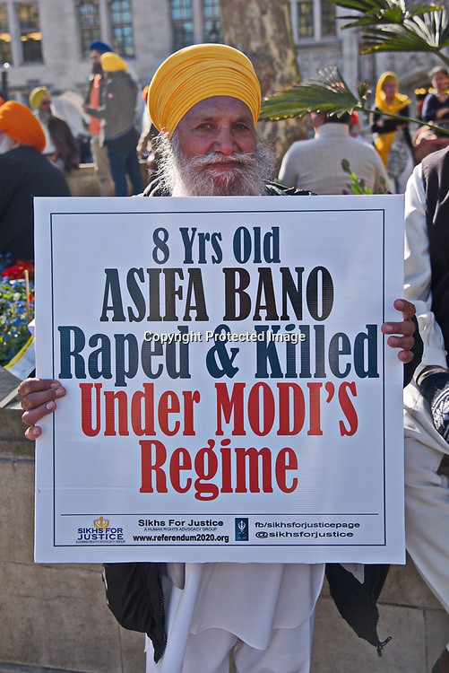 Entire Indian and Kashmir community from London join Protesters chant Modi Go back, Indian army go back, Modi and Indian army is a terrorists as Londons Kashmiri community demonstrates at Parliament Square on April 18, 2018. The demonstrators denounced Indian war crimes against Kashmiri people, rejected the presence of Indian Prime Minister Narendra Modi in the United Kingdom, and protested the rape and murder of an 8-year-old Muslim child.