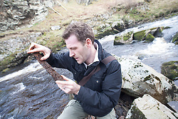 Pic with found metal bar. Historian Ashley Cowie at the 'The Devil's Gold' in Dirlot, Caithness. He is doing a seven part series for The Scottish Sun on Scotland's treasure hunts at the end of April..©Michael Schofield.