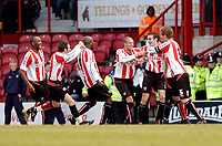 Photo: Leigh Quinnell.<br /> Brentford v Swansea City. Coca Cola League 1.<br /> 26/12/2005. Brentfords Kevin O'Connor(2nd from right) celebrates his goal with his team mates.