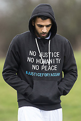 "© Licensed to London News Pictures. 06/01/2017. Huddersfield, UK. A man wearing a hoodie with "" No justice no humanity no peace #justiceforyassar"" at the funeral of Yassar Yaqub at Hey Lane Cemmetary in Huddersfield, West Yorkshire. Yaqub, 28, from Huddersfield, was shot dead in a car stopped near junction 24 of the M62 as part of a planned police operation. Photo credit: Joel Goodman/LNP"