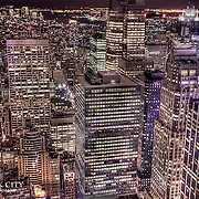 An elevated look at the densely packed Manhattan scene from the observation deck at Rockefeller Center