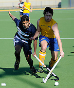 Jared Panchia of Auckland trys to gather in the ball. 2014 Ford National Hockey League. Southern v  Auckland at Alexander McMillan Hockey Centre, Dunedin, New Zealand. Saturday 30 August 2014. New Zealand. Photo: Richard Hood/photosport.co.nz