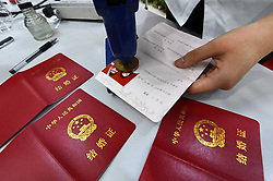 August 28, 2017 - Weifan, Weifan, China - Weifang, CHINA-28th August 2017: (EDITORIAL USE ONLY. CHINA OUT) Couples flock to register for marriage in Weifang, east China's Shandong Province, on Chinese Valentine's Day. (Credit Image: © SIPA Asia via ZUMA Wire)