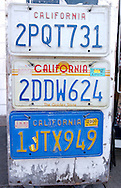 Old California license plates at a vendor's souvenir stand on the Embarcedaro in the Fisherman's Wharf neighborhood of San Francisco, CA on Tuesday, August 3, 2004.