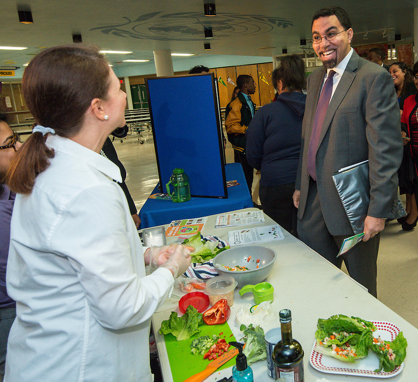 Acting US Secretary of Education John King, right, tours the Apollo Market during a visit to Sharpstown High School, January 15, 2016.