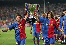 Xavi Hernandez (L) and Carlos Puyol  celebrate with the La Liga trophy. Barcelona v Osasuna (0-1), La Liga, Nou Camp, Barcelona, 23rd May 2009.