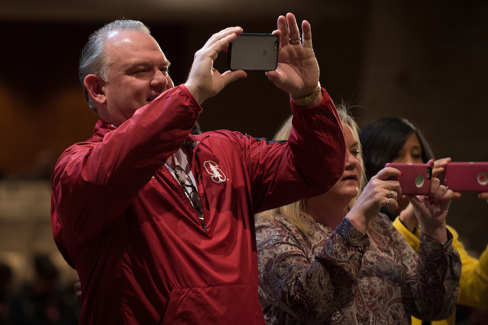 Marc Smith, father of Flower Mound Marcus High School senior tight end Kaden Smith, takes a photo of his son before he signs his National Letter of Intent to play football at Stanford University during his high school signing day on February 3, 2016. (Cooper Neill for The New York Times)