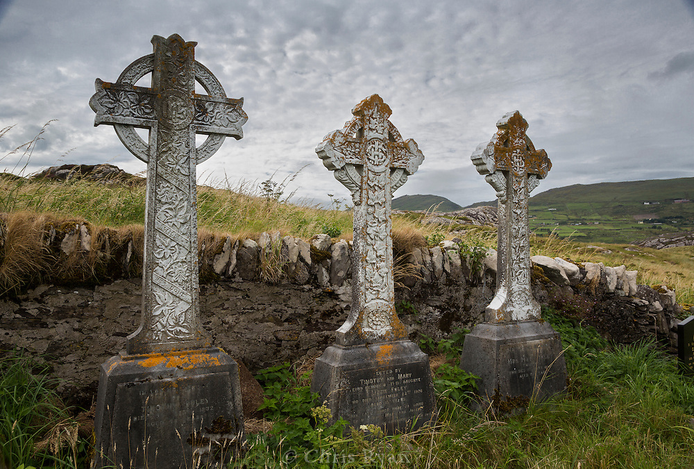 Celtic cross tombstones at church on Abbey Island, County Kerry, Ireland