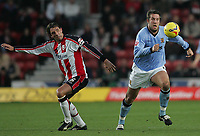 Photo: Lee Earle.<br /> Southampton v Hull City. Coca Cola Championship. 04/11/2006. Hull's Jon Parkin (R) and Claus Lundekvam of Southampton.