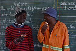Nov. 19, 2014 - Mthatha, Eastern Cape, South Africa - Workers enjoying their food break when working at Ngcendese School. Mandela's homeland of Mthatha. Eastern Cape, South Africa. (Picture by: Artur Widak/NurPhoto) (Credit Image: © Artur Widak/NurPhoto/ZUMA Wire)