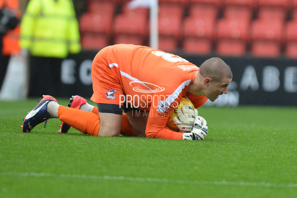 Scunthorpe United goalkeeper Joe Anyon collects the ball during the Sky Bet League 1 match between Swindon Town and Scunthorpe United at the County Ground, Swindon, England on 14 November 2015. Photo by Mark Davies.