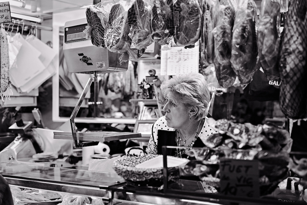 Woman behind meat counter, Boqueria market
