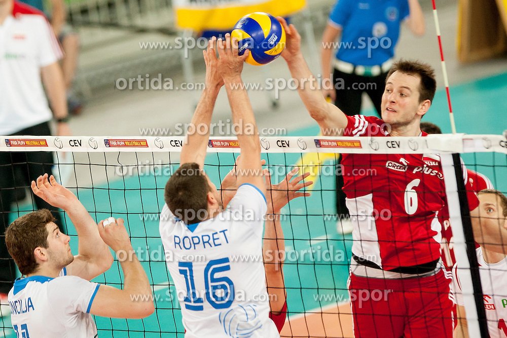 Krzysztof Ignaczak #16 of Poland and Gregor Ropret #16 of Slovenia during volleyball match between National teams of Slovenia and Poland in 4th Qualification game of CEV European Championship 2015 on May 23, 2014 in Arena Stozice, Ljubljana, Slovenia. Photo by Urban Urbanc / Sportida