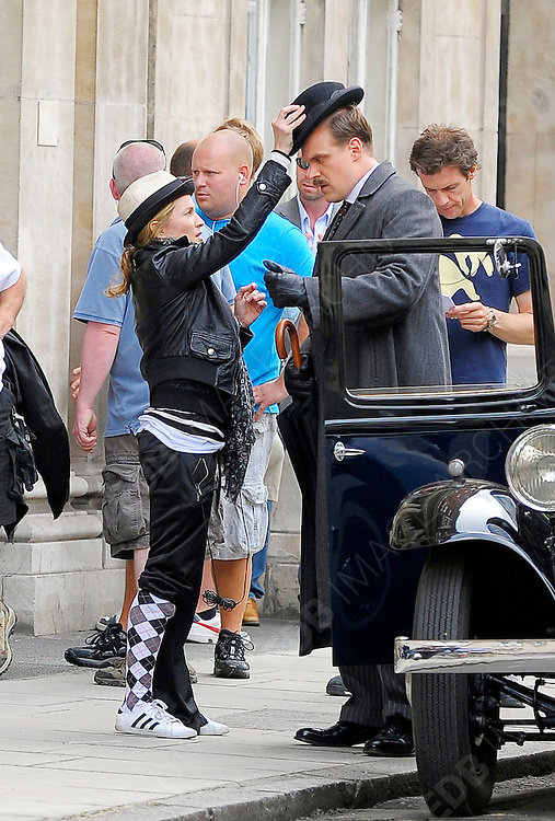 08.AUGUST.2010 - LONDON<br /> <br /> MADONNA WITH DAUGHTER LOURDES AND HER TWO ADOPTED CHILDREN DAVID BANDI AND MERCY JAMES WHO SHE GAVE A BIG KISS ON THE FILM SET OF HER NEW FILM W.E. WHICH SHE IS DIRECTING BEFORE LEAVING THE FILM SET BY BICYCLE AND HEADING HOME.<br /> <br /> BYLINE MUST READ: EDBIMAGEARCHIVE.COM<br /> <br /> *THIS IMAGE IS STRICTLY FOR UK NEWSPAPERS AND MAGAZINES ONLY*<br /> *FOR WORLDWIDE SALES AND WEB USE PLEASE CONTACT EDBIMAGEARCHIVE - 0208 954 5968*
