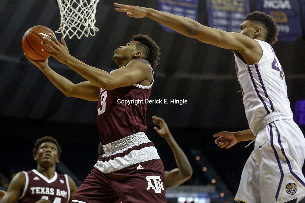 Feb 4, 2017; Baton Rouge, LA, USA; Texas A&M Aggies guard Admon Gilder (3) shoots over LSU Tigers forward Wayde Sims (44) during the first half at the Pete Maravich Assembly Center. Mandatory Credit: Derick E. Hingle-USA TODAY Sports