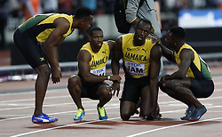 2017?8?13?.       ?????1???——????????????4X100?????.         8?12?????????????????????.        ???????????2017?????????4X100????????????????????????.         ????????.(SP) BRITAIN-LONDON-ATHLETICS-WORLD CHAMPIONSHIPS-DAY 9.(170813) -- LONDON, Aug. 13, 2017 -- Usian Bolt of Jamaica leaves the track after pulling up injured in the men's 4x100m relay final on Day 9 at the IAAF World Championships 2017 in London, Britain on Aug. 12, 2017. (Credit Image: © Han Yan/Xinhua via ZUMA Wire)