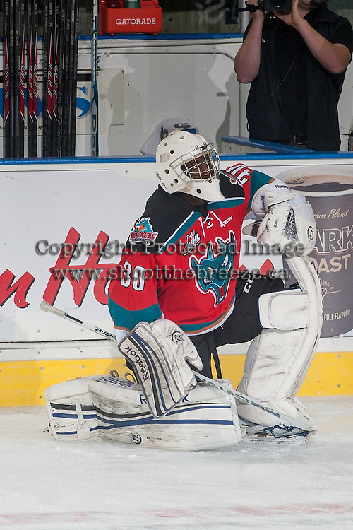 KELOWNA, CANADA - NOVEMBER 7: Michael Herringer #30 of Kelowna Rockets stretches during warm up against the Spokane Chiefs on November 7, 2014 at Prospera Place in Kelowna, British Columbia, Canada.  (Photo by Marissa Baecker/Shoot the Breeze)  *** Local Caption *** Michael Herringer;
