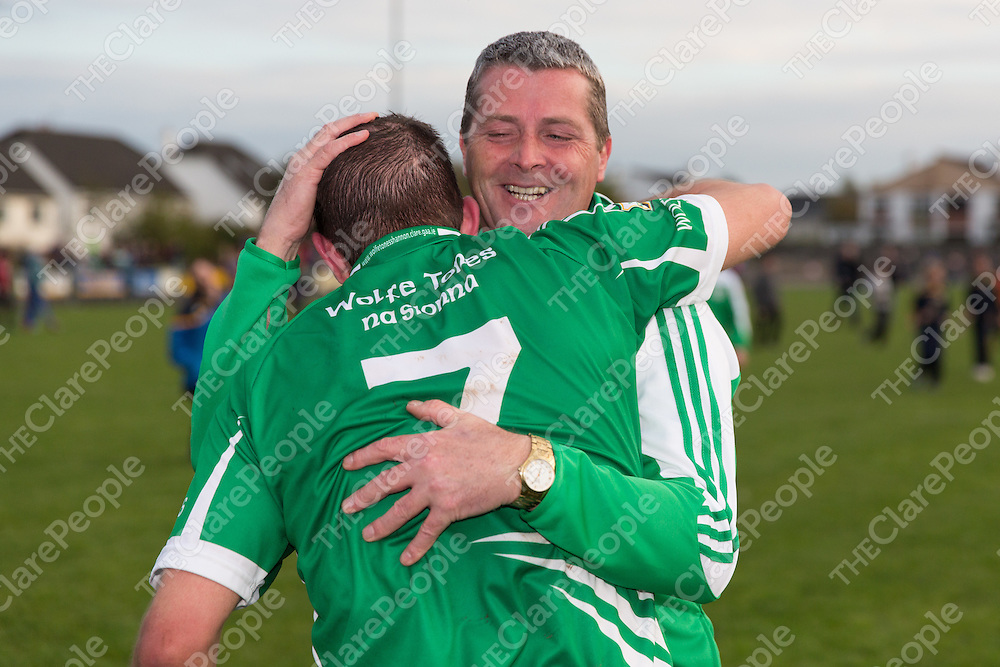 Wolfe Tones Management celebreate with the team at the final whistle