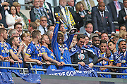 AFC Wimbledon striker Adebayo Azeez (14) lifting the trophy during the Sky Bet League 2 play off final match between AFC Wimbledon and Plymouth Argyle at Wembley Stadium, London, England on 30 May 2016.