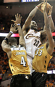 Washington Wizards forward Antawn Jamison (L) and teammate Brendan Haywood (R) try to stop Cleveland Cavaliers forward LeBron James (C) during the fourth quarter of their game at the Quicken Loans Arena in Cleveland, Ohio, USA,19 April 2008. The Cavaliers beat the Wizards 93-86 during the first game of the NBA Eastern Conference playoffs.