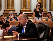 Adam Runyons' family reacts after he spoke at his hearing Monday afternoon. Runyons pleaded guilty to the murder of his father in May 2014. He received 18 years-life in prison for brutally killing his father with a machete.