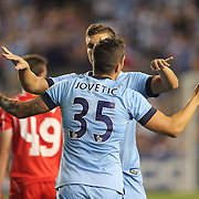 Stevan Jovetic, Manchester City, is congratulated after scoing during the Manchester City Vs Liverpool FC Guinness International Champions Cup match at Yankee Stadium, The Bronx, New York, USA. 30th July 2014. Photo Tim Clayton