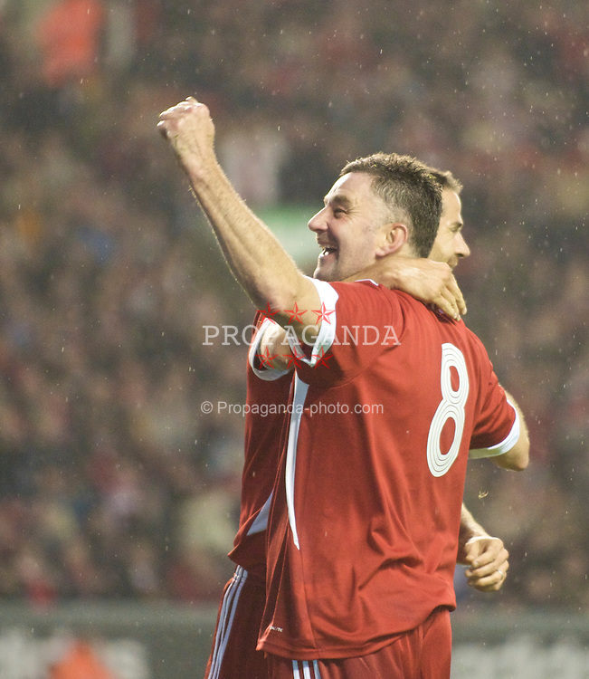 LIVERPOOL, ENGLAND - Thursday, May 14, 2009: Liverpool Legends' John Aldridge celebrates his goal against All Stars with team-mate Jamie Redknapp during the Hillsborough Memorial Charity Game at Anfield. (Photo by David Rawcliffe/Propaganda)