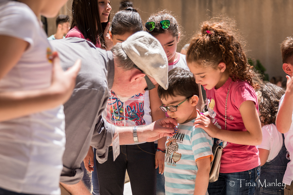 Tim giving out stickers at Sunday School at the Kamishli Evangelical Presbyterian Church.