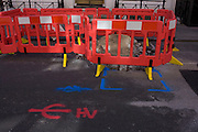 Roadworks barriers and ground markings in central London.