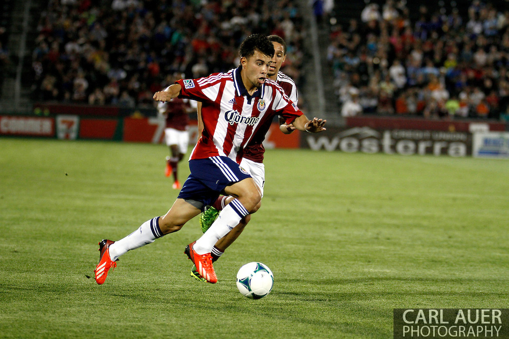 May 25th, 2013 Commerce City, CO - Chivas USA midfielder Carlos Alvarez (20) breaks towards the goal with the ball in the second half of action in the MLS match between Chivas USA and the Colorado Rapids at Dick's Sporting Goods Park in Commerce City, CO