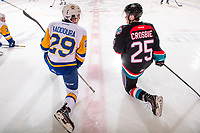 KELOWNA, CANADA - DECEMBER 1:  Majid Kaddoura #29 of the Saskatoon Blades catches up with Kyle Crosbie #25 of the Kelowna Rockets at center ice during warm up on December 1, 2018 at Prospera Place in Kelowna, British Columbia, Canada.  (Photo by Marissa Baecker/Shoot the Breeze)