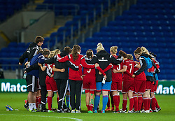 CARDIFF, WALES - Tuesday, August 21, 2014: Wales players after the FIFA Women's World Cup Canada 2015 Qualifying Group 6 match against England at the Cardiff City Stadium. (Pic by David Rawcliffe/Propaganda)