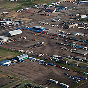 Miles of industry sprawl in Williston, North Dakota service the oil boom in the Bakken formation...Known for the beauty of its great plains, North Dakota has long been the least populated state in the country. Because of the Bakken oil boom, everyday, mostly men, pour in from across the nation looking for work. The small town of Williston has exploded as a result. Ten years ago Williston, North Dakota was a quiet agricultural town with a population around 12,000. In a decade the population has more than doubled to over 30,000. More than half of Williston's residents now work in oil-related jobs and the city's unemployment rate is at 1 percent, which is the lowest in the U.S...