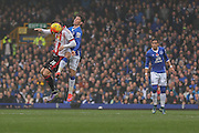 Everton midfielder Bryan Oviedo fouls Sunderland forward Steven Fletcher during the Barclays Premier League match between Everton and Sunderland at Goodison Park, Liverpool, England on 1 November 2015. Photo by Simon Davies.
