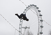 UNITED KINGDOM, London: 10 April 2018. An acrobat from Circus Abyssinia is launched in the air in front of the London Eye as they launch their headline run at the Underbelly Festival Southbank. The Ethiopian circus act Circus Abyssinia: Ethiopian Dream's will help celebrate 250 years of circus and 10 years of the Underbelly festival. Rick Findler / Story Picture Agency