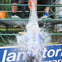 St Johnstone's Tom Scobbie is subjected to the Ice Bucket Challenge by Callum Davidson and Fraser Wright...29.08.14<br /> Picture by Graeme Hart.<br /> Copyright Perthshire Picture Agency<br /> Tel: 01738 623350  Mobile: 07990 594431