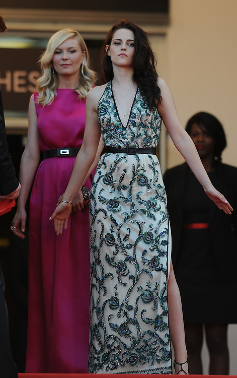 Actress  Kristen Stewart (L) and Kirsten Dunst during the Red Carpet of 'On The Road' at  65th Annual Cannes Film Festival at Palais des Festivals on May 23, 2012 in Cannes, France..Photo Ki Price.