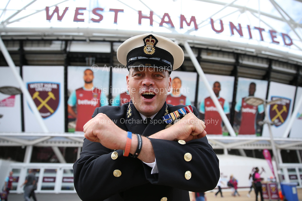 a Royal Navy officer collecting for the Help for Heroes charity poses for a photo while doing the Iron Cross outside London Stadium before k/o. Premier league match, West Ham Utd v AFC Bournemouth at the London Stadium, Queen Elizabeth Olympic Park in London on Sunday 21st August 2016.<br /> pic by John Patrick Fletcher, Andrew Orchard sports photography.