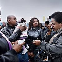 Nederland, Amsterdam , 14 maart 2014.<br /> De Nigeriaanse Clara Mwaebi rechts moet 2 maanden de gevangenis in ivm vals paspoort.<br /> Een erkend slachtoffer van mensenhandel moet 2 maanden de cel in voor het bezit van het valse paspoort dat zij kreeg van de mensensmokkelaar.Ze draait op voor de fout van haar advocaat<br /> Foto:Jean-Pierre Jans