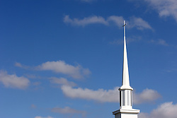 14 March 2008: A church steeple with a cross at the top shines in the midday sun against a bright blue spring sky.
