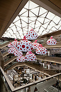 Ginza Six, shopping mall in Ginza district. in Tokyo, with a Yayoi Kusama installation in the central atrium