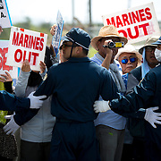 OKINAWA, JAPAN - JUNE 17 : Police block the Anti U.S. Base relocation protesters during a rally outside the Camp Schwab on June 17, 2016 in Nago, Okinawa, Japan. Protests have grown more intense in the past days due to the past incident of rape of a Japanese woman and drunk driving in Okinawa over American military presence in Japan. Photo: Richard A. de Guzman