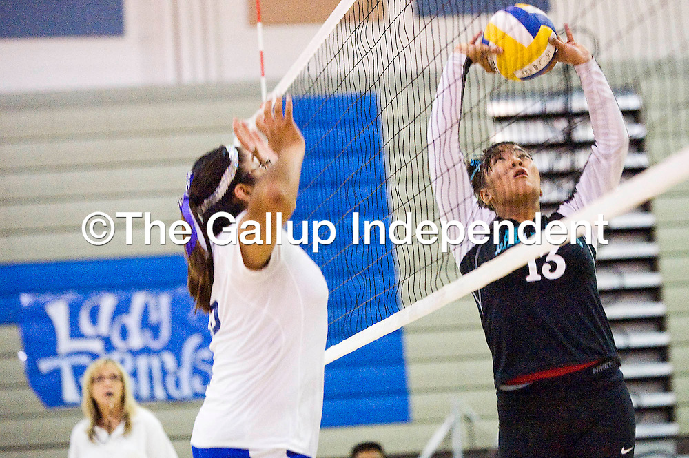 110112       Cable Hoover<br /> <br /> Navajo Prep Eagle Jasmine Coleman (13) sets up a shot on the Zuni Thunderbirds Thursday at Zuni High School.