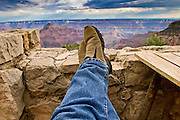 10 AUGUST 2003 -- GRAND CANYON NATIONAL PARK, AZ: A tourist on the porch of the Grand Canyon Lodge on the north rim of the Grand Canyon National Park in northern Arizona.  PHOTO BY JACK KURTZ