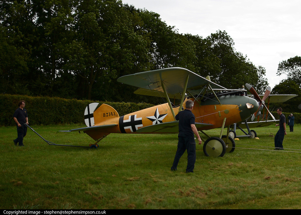 © Licensed to London News Pictures. 29/08/2012. Old Warden, UK. Workers move the Albatros DVa, a reproduction, across the airfield.  The Royal Airforce Museum unveils three World War One aircraft at the Shuttleworth Aerodrome in Bedfordshire today, 29th August 2012.  The Snipe, Albatros DVa and RE8 will fly in airshows before going on public display at the Museum's London site Photo credit : Stephen Simpson/LNP