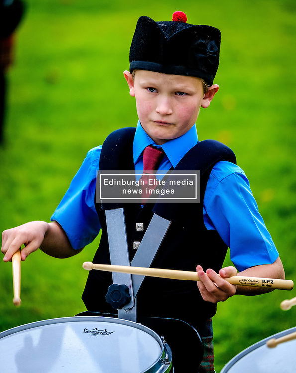Peebles, Scotland UK  3rd September 2016. Peebles Highland Games, the biggest 'highland' games in the Scottish  Borders took place in Peebles on September 3rd 2016 featuring pipe band contests, highland dancing competitions, haggis hurling, hammer throwing, stone throwing and other traditional events.<br /> <br /> Pictured:  a young drummer playing in a pipe band<br /> <br /> (c) Andrew Wilson | Edinburgh Elite media
